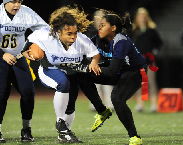 Foothill running back Chloe Collins, left, collides with Centennial safety Chantay Dixon aft ...