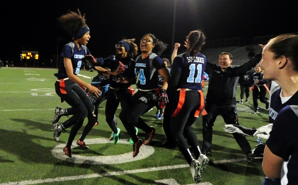 Centennial players celebrate their 25-20 victory over Foothill in the CCSD Division I Flag ...