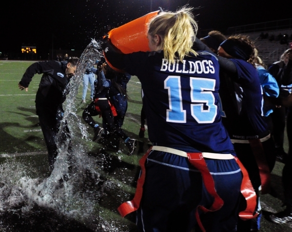 Centennial players dunk head coach John Roberts with water after defeating Foothill in the C ...