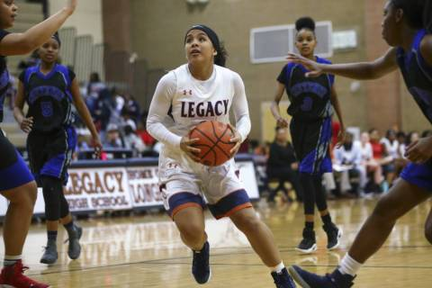 Legacy's Taeha Pankey (3) drives to the basket against Cheyenne during a basketball ga ...