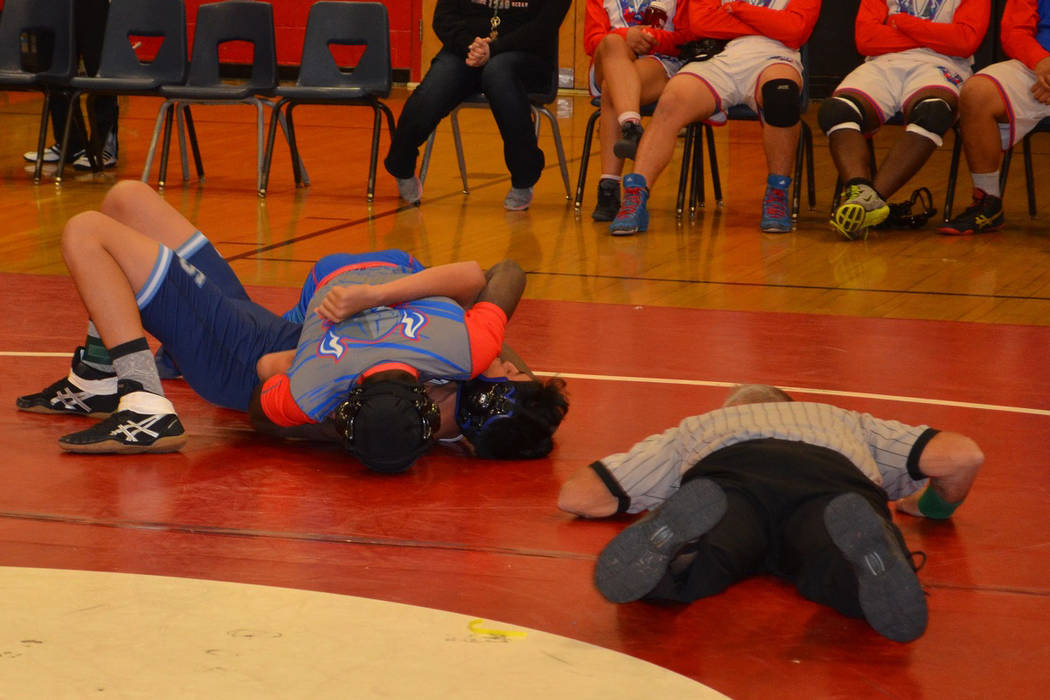 Valley 145-pounder Xzavier Maheia pins his first round opponent, Canyon Springs' Rober ...