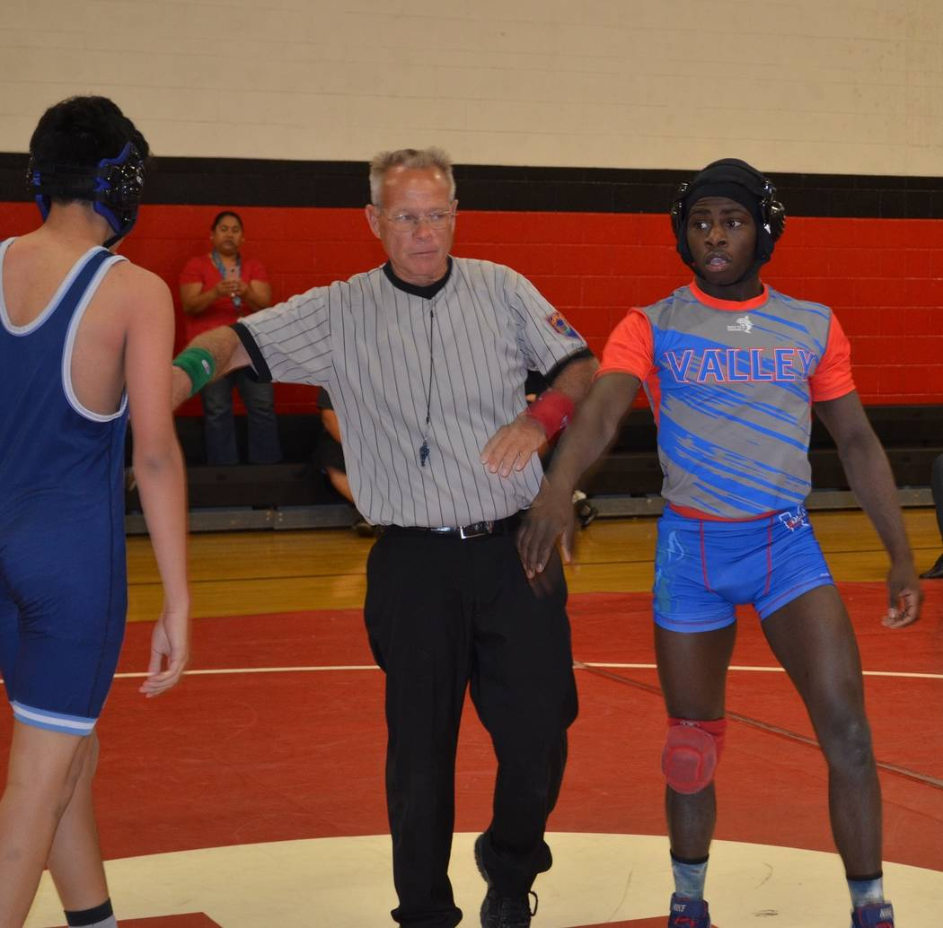 Valley 145-pounder Xzavier Maheia (right) is aiming for a berth into next week's state ...