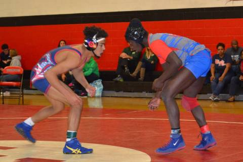 Valley 145-pounder Xzavier Maheia (right) looks to tie up with Liberty's Jayden Rookhu ...