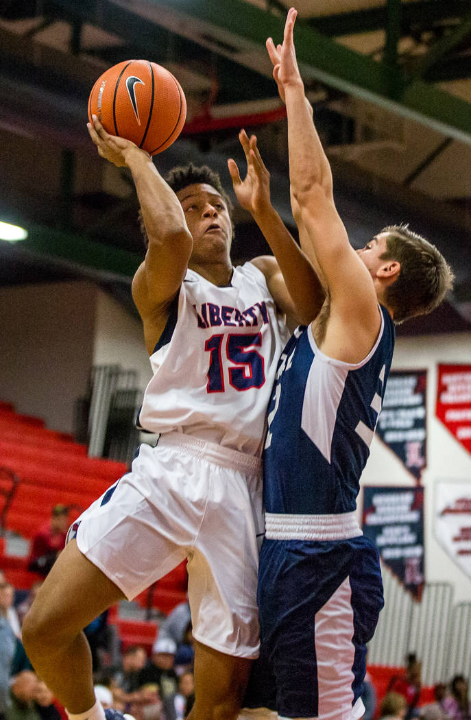 Liberty's Cameron Burist (15) tries to shoot around the defense of Foothill's Dy ...