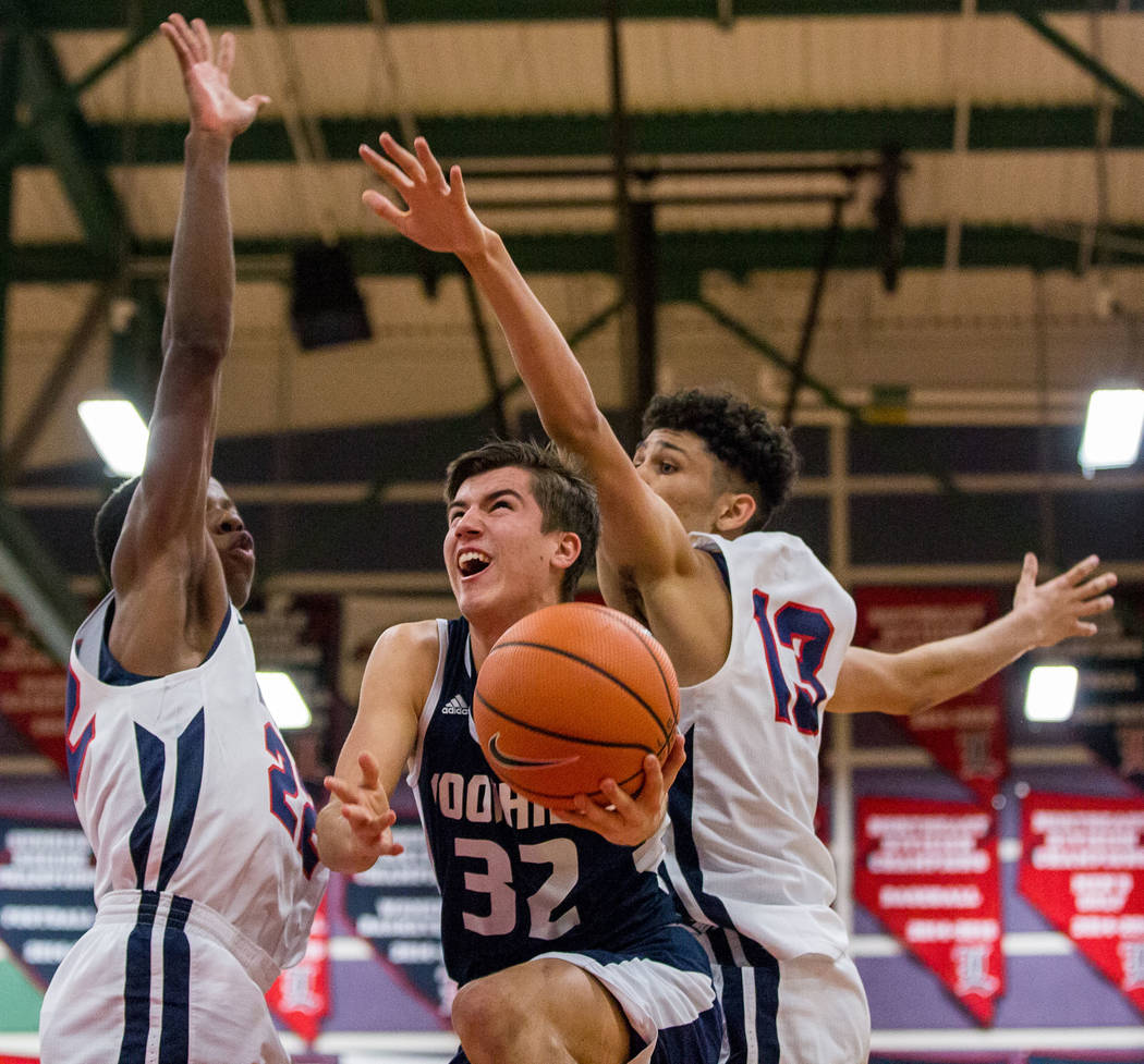 Foothill's Dylan Hushaw (32) looks for a shot while Liberty defenders Jordan Wafer (22 ...