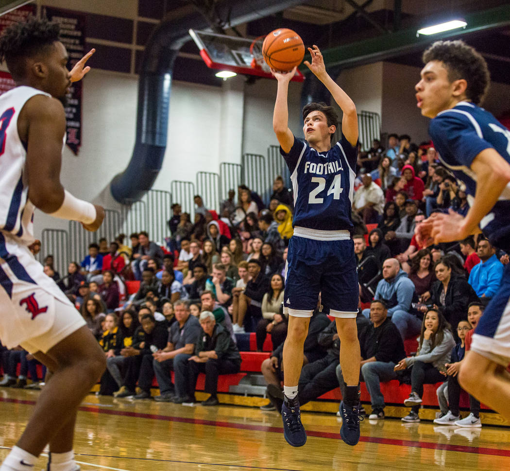 Foothill's Anthony Martin (24) looks for a 3-pointer while Jace Roquemore (22), right, ...