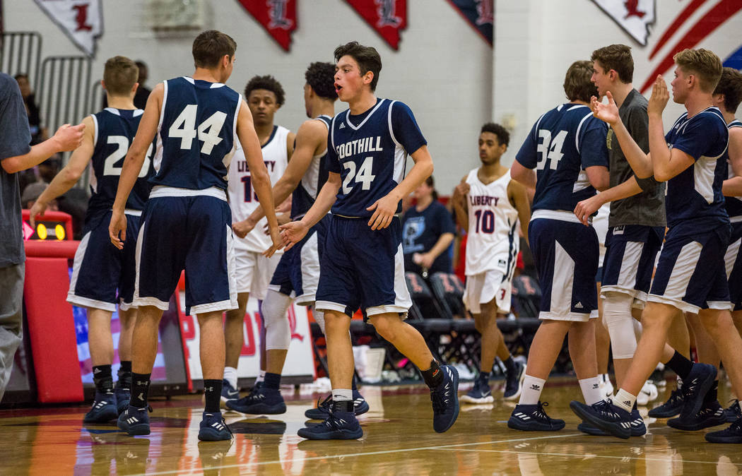 Foothill players cheer after defeating Liberty 69-65 at Liberty High School in Henderson on ...