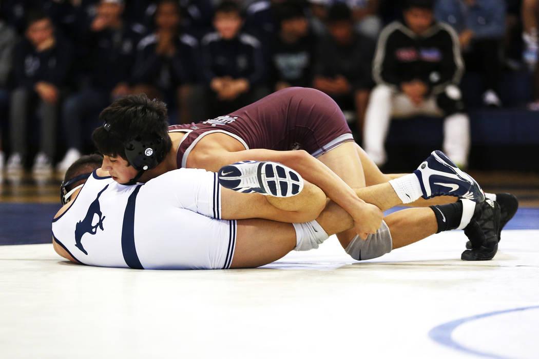 Nathanial Rodriguez, of Cimarron-Memorial High School, pins down Matthew Van Riel, of Shadow ...