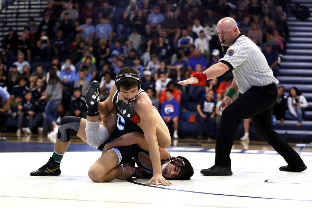 Nico Antuna, of Centennial High School, left, wrestles Daniel Rodriguez, of Cimarron-Memoria ...