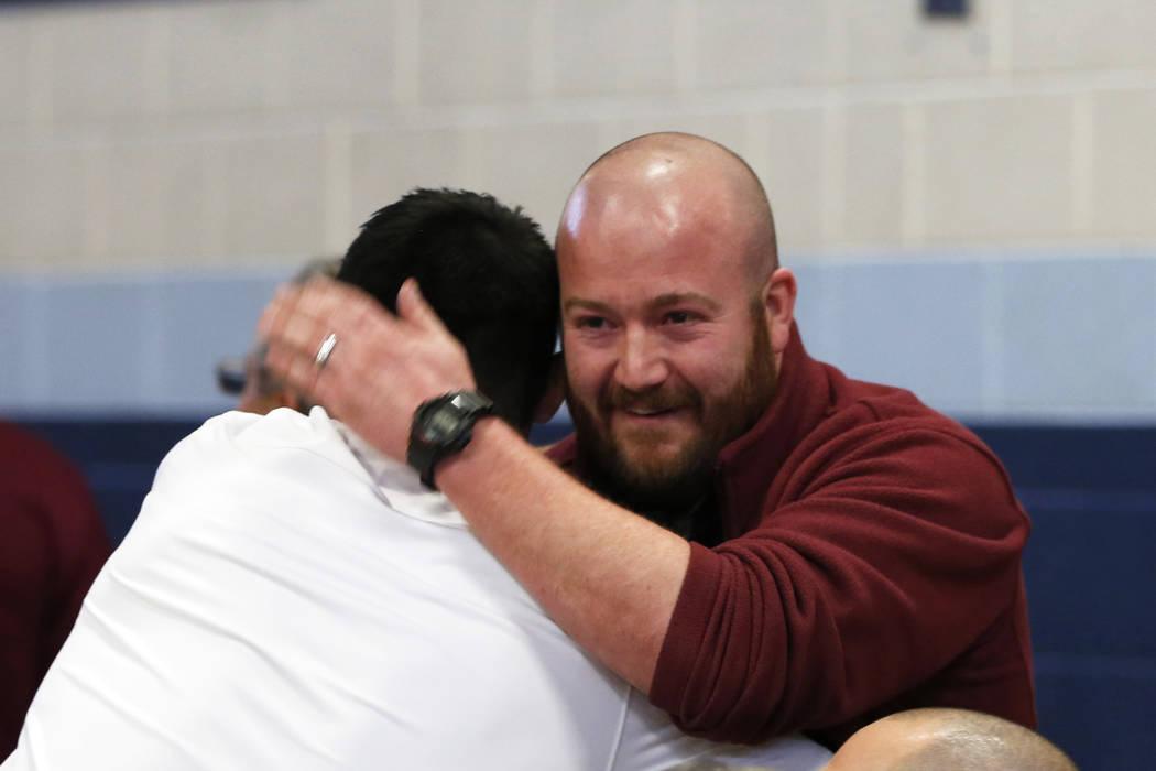 John Brokish, assistant coach for Cimarron-Memorial High School, celebrates his school&#8217 ...