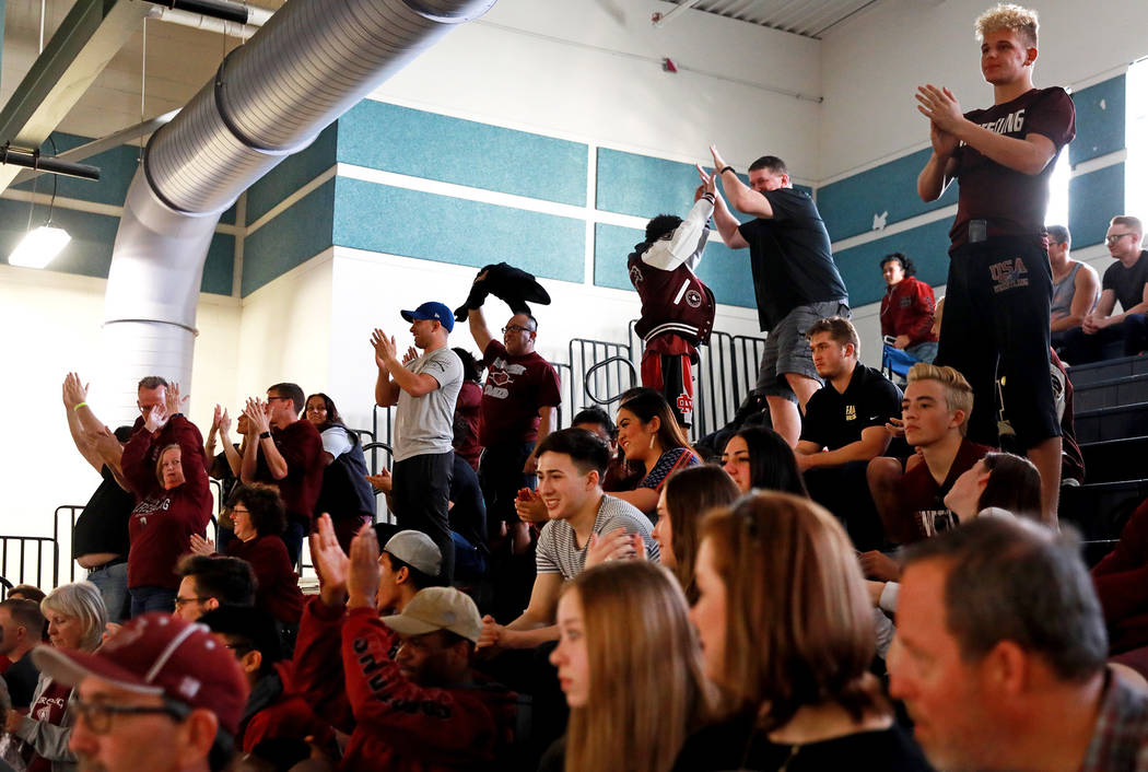 Crowds cheer on Saturday during the Sunset Region Wrestling Finals at Centennial High School ...