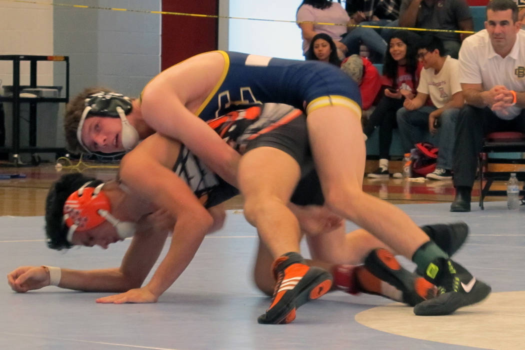 D.J. Reese of Boulder City, top, wrestles Marc Gonzales of Chaparral in the 132-pound champi ...