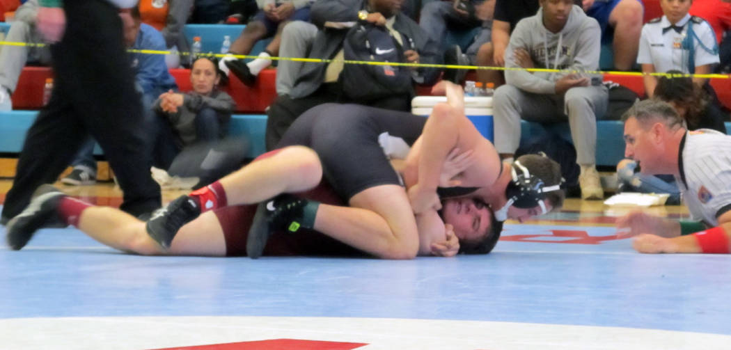 Cresent Crandall of Virgin Valley, top, wrestles Cole Walker of Pahrump Valley in the 182-po ...