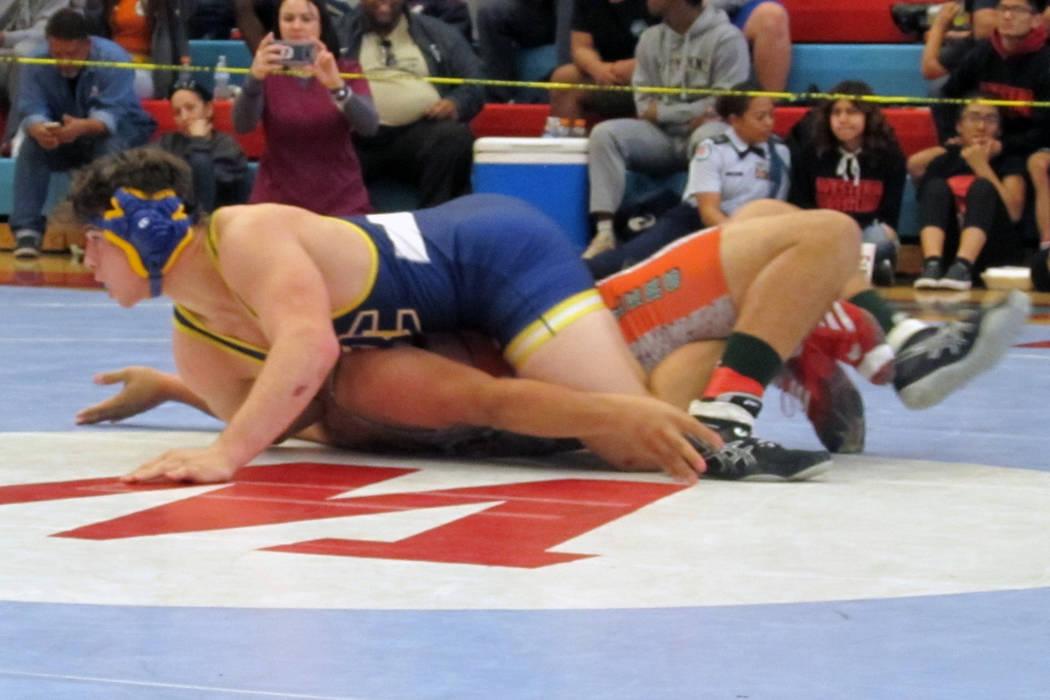 Ryan Vanario of Boulder City, top, wrestles Sergio Salaza of Mojave in the 195-pound champio ...