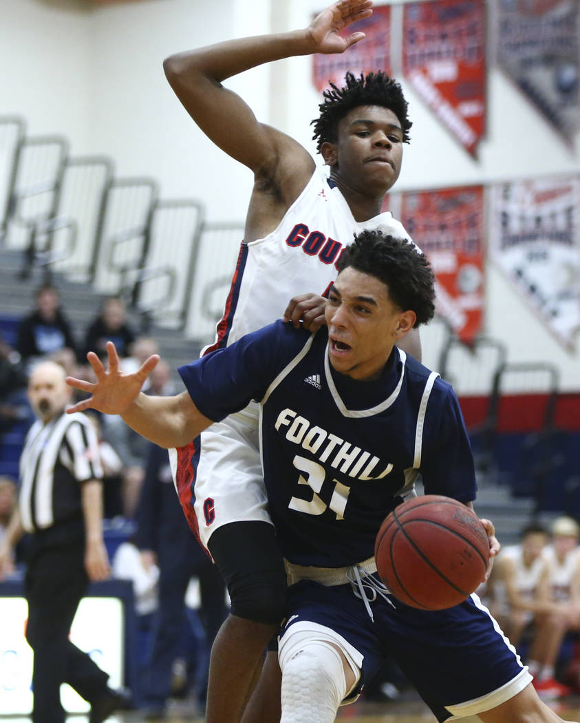 Foothill's Marvin Coleman (31) drives against Coronado's Jaden Hardy (1) during ...