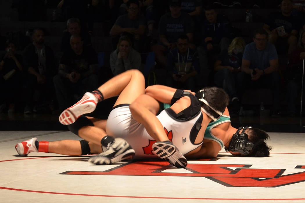 Las Vegas' Antonio Saldate looks to turn Green Valley's David Kalayanaprapruit f ...