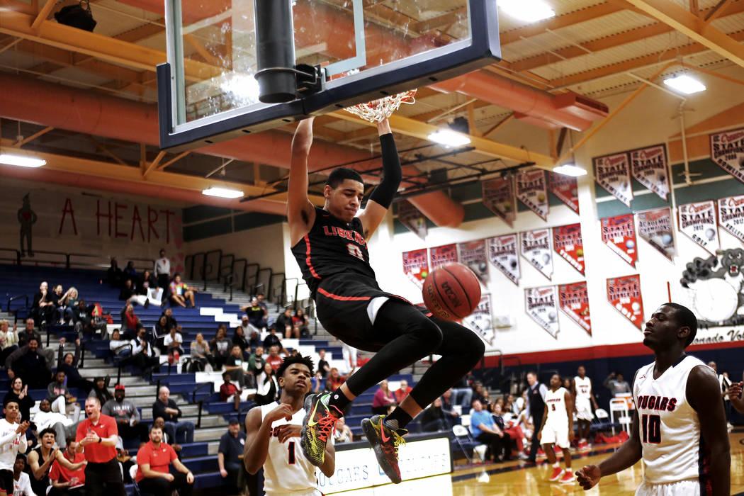 Liberty High School's Julian Strawther (0) slam dunks in a game against Coronado High ...
