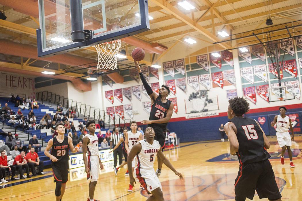 Liberty High School's Davion Ware (23) attempts a basket in a game against Coronado Hi ...