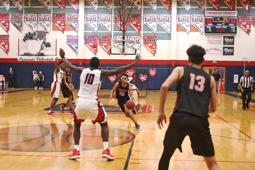 Liberty High School's Jordon Holt (10) prepares to dribble past Coronado High School&# ...
