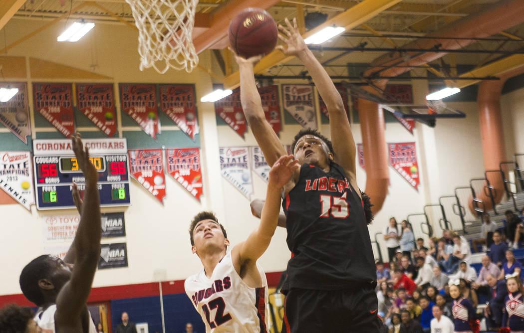 Liberty High School's Cameron Burist (15) attempts a basket against Coronado High Scho ...