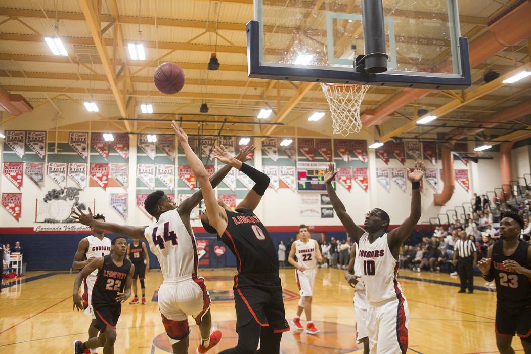 Liberty High School's Julian Stawther (0) attempts a basket against Coronado High Scho ...