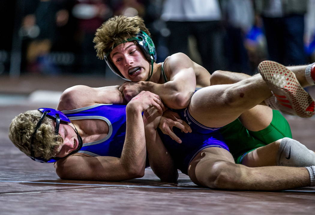 William Zernich of Green Valley attempts to pin down Owen Jones of Spanish Springs while wre ...