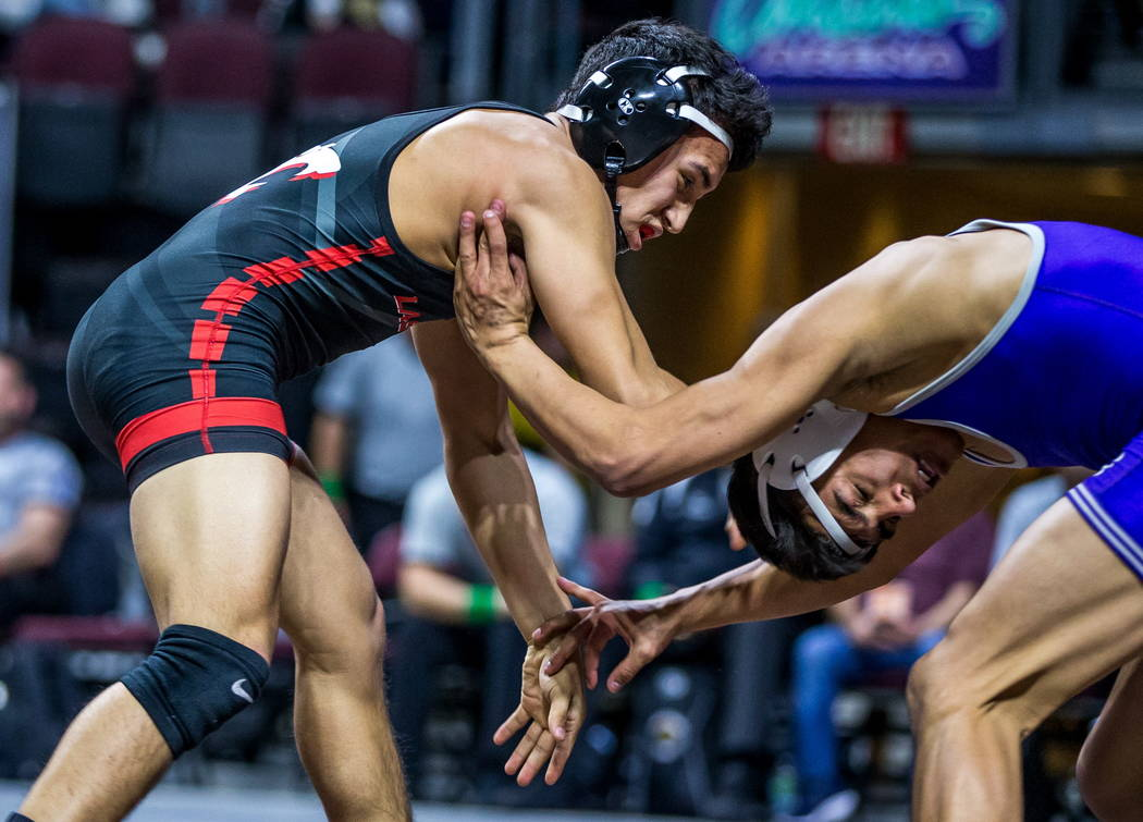 Antonio Saldate of Las Vegas, left, and Jacob Ruiz of Spanish Springs wrestle in the 4A 120 ...