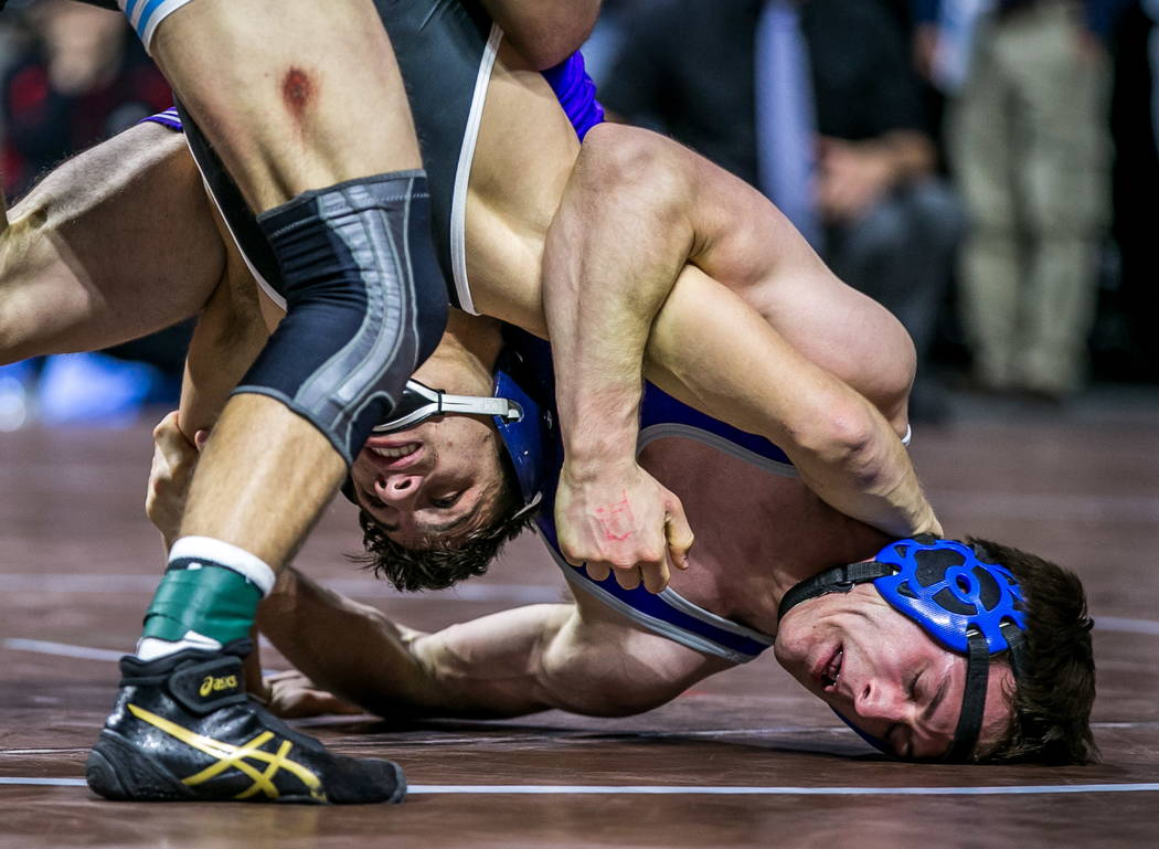 Nico Antuna of Centennial, left, wrestles with Werner Hunter of Spanish springs in the 4A 13 ...