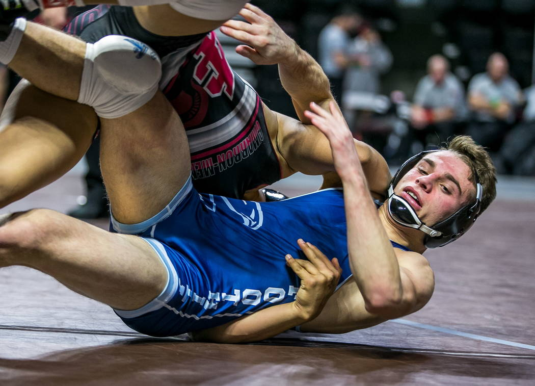 Amado Castellon of Cimarron-Memorial, top, tries to take down Wyatt English of Foothill whil ...