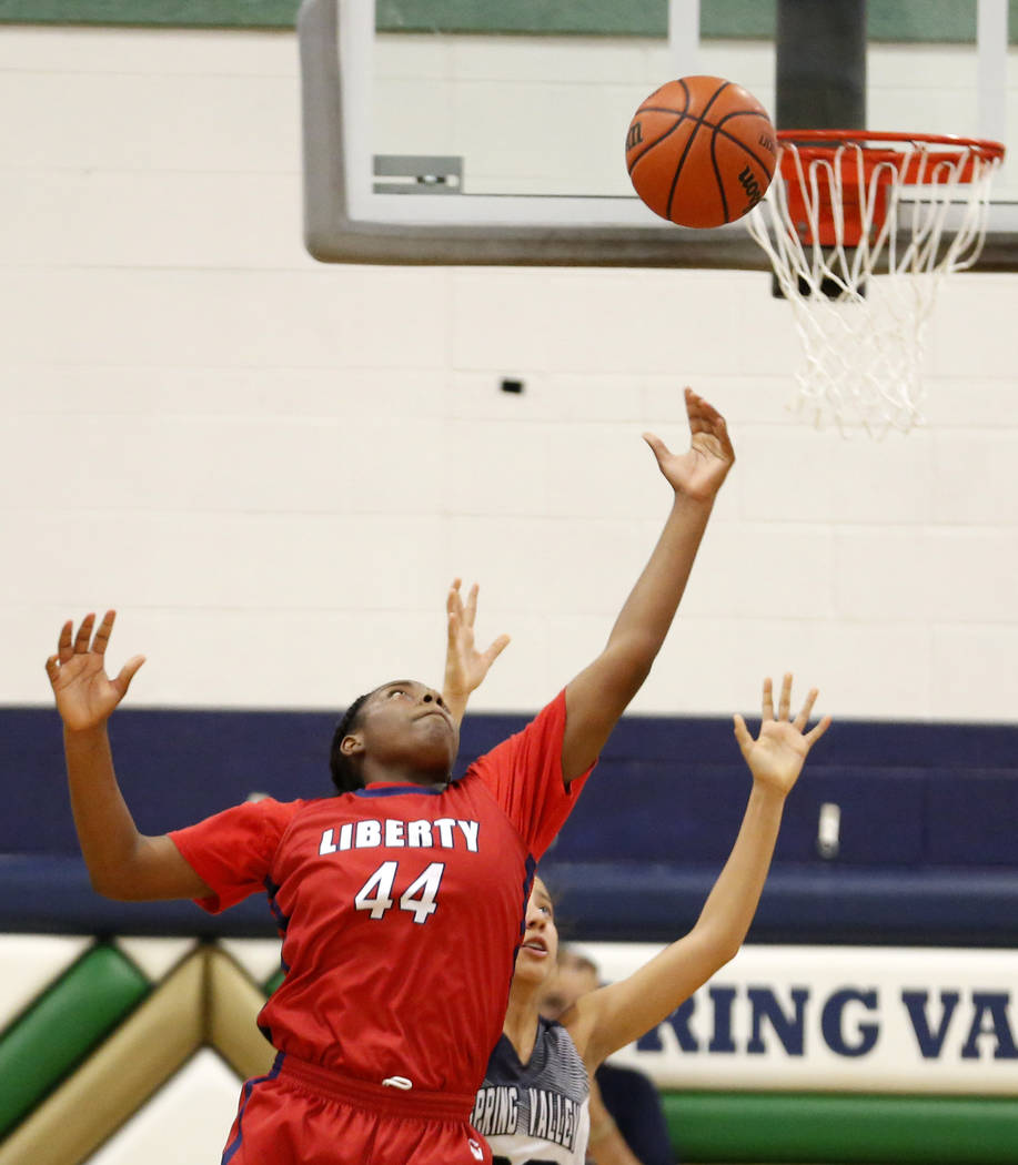 Liberty High's Dre'una Edwards (44) shoots against Spring Valley during a girl&# ...
