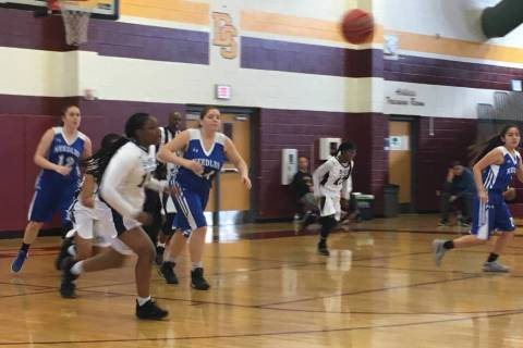 The Needles girls basketball team moves the ball up the court against Democracy Prep in thei ...