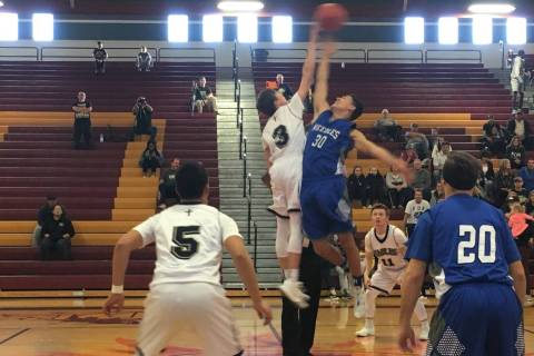 Needles and Lake Mead boys basketball players at the opening tip-off of their Class 2A South ...