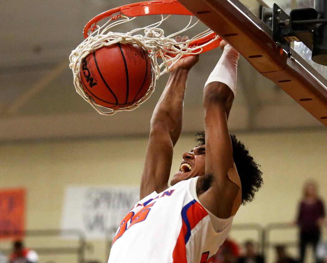Bishop Gorman's Jamal Bey (35) dunks the ball against Clark during the Sunset Region b ...