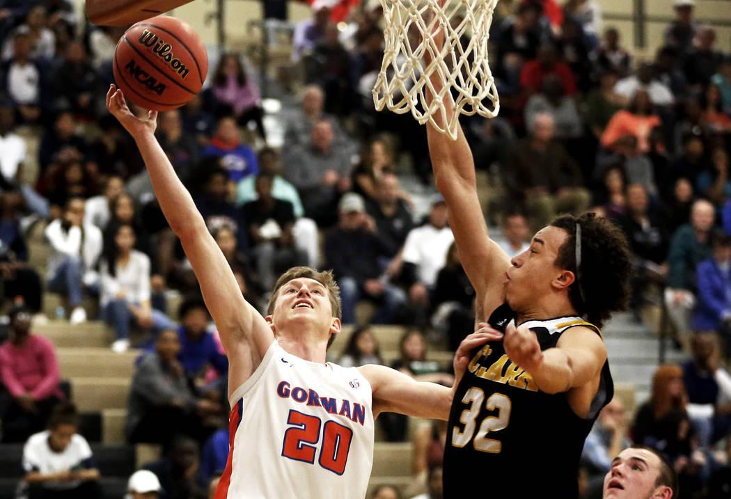 Bishop Gorman's Noah Taitz (20) shoots against Clark's Ian Alexander (32) durin ...