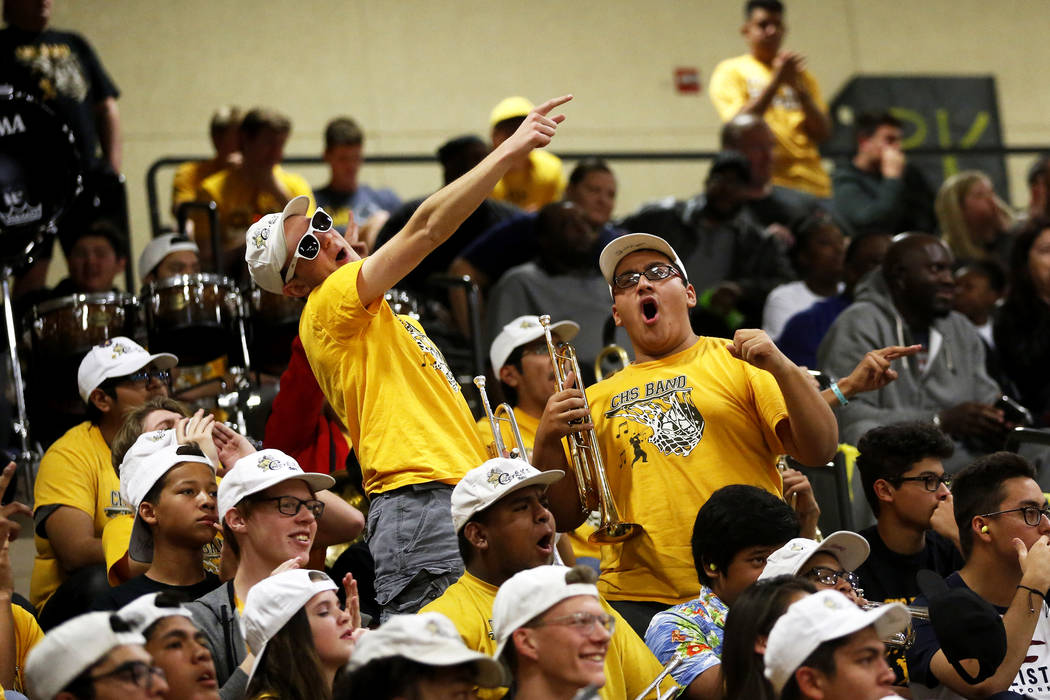 Fans cheer during the Sunset Region boys basketball championship at Legacy High School in No ...