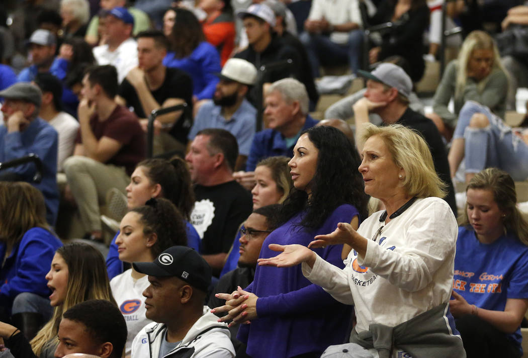Fans react during the Sunset Region boys basketball championship at Legacy High School in No ...