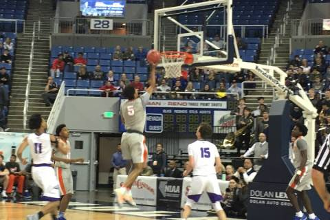 Bishop Gorman's Jamal Bey goes up for a shot during the team's Class 4A state se ...