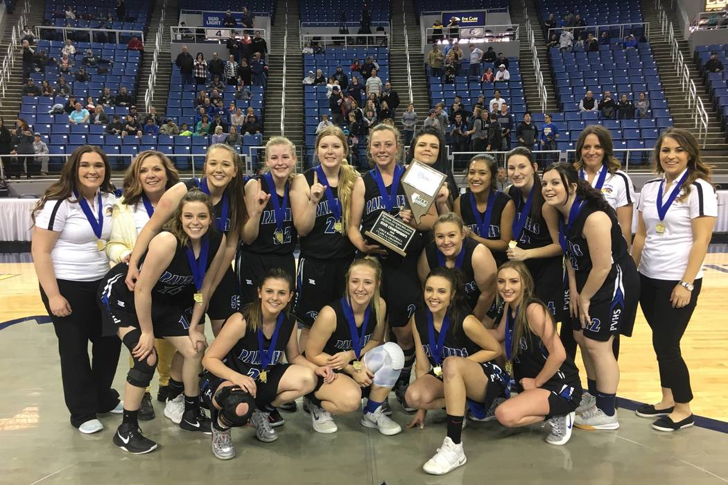 Pahranagat Valley players celebrate their 58-43 win over Wells for the Class 1A girls state ...