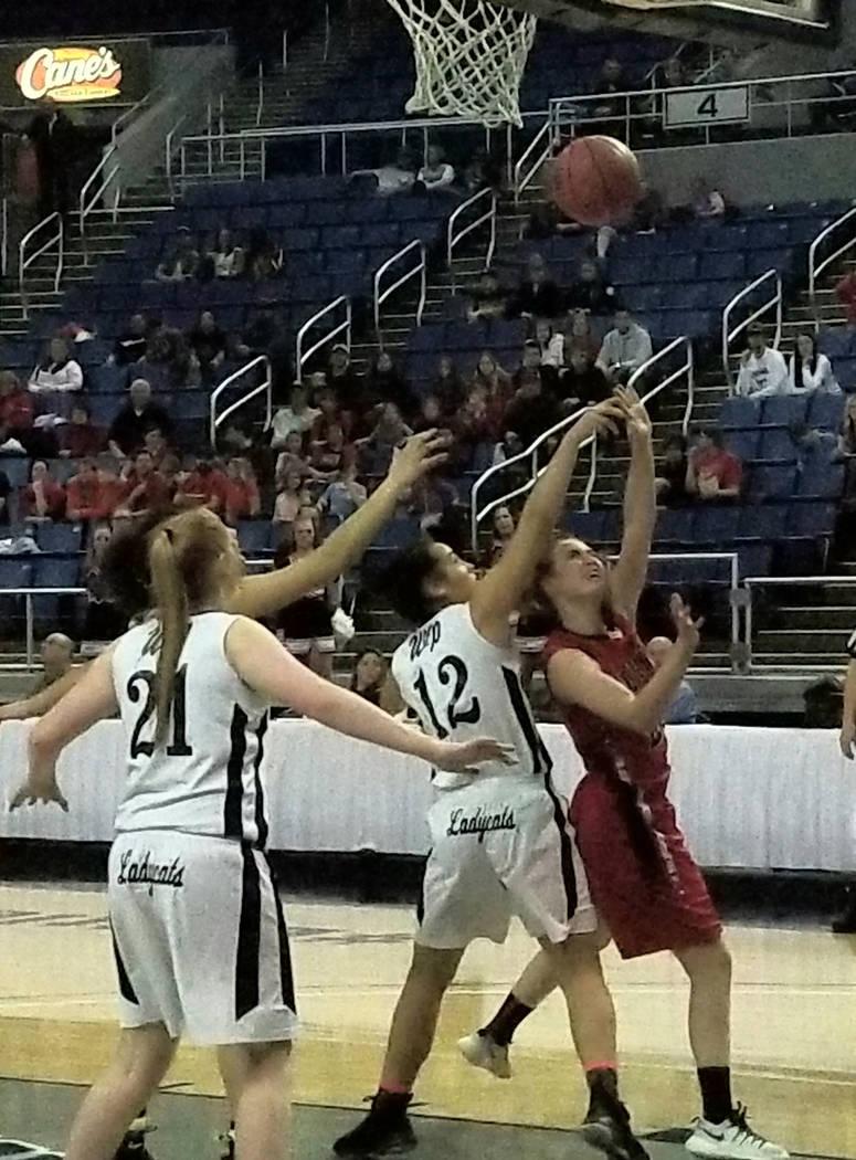 Lincoln County's Kendra Mathews takes a shot over White Pine's Evan Kingston dur ...