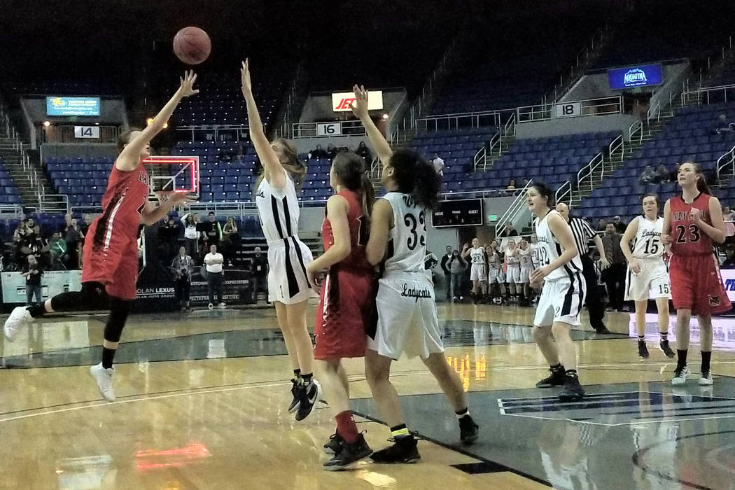 Lincoln County's Brynlee Wadsworth tries a desperation shot at the buzzer during the C ...