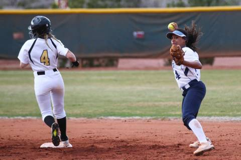 Centennial's Kiana Tate (4) throws to first base after getting out Faith Lutheran&#821 ...