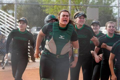 Palo Verde catcher Grace Chavez celebrates after Lauryn Barker scored a run during the third ...