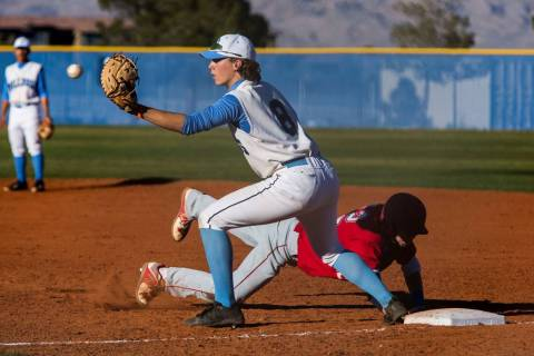 Centennial first baseman Adam Hazen looks to make a play while Arbor View's Jesse Pier ...