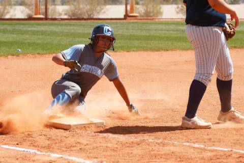 Centennial's shortstop Kiana Tate (4) slides safely unto third base against North High ...