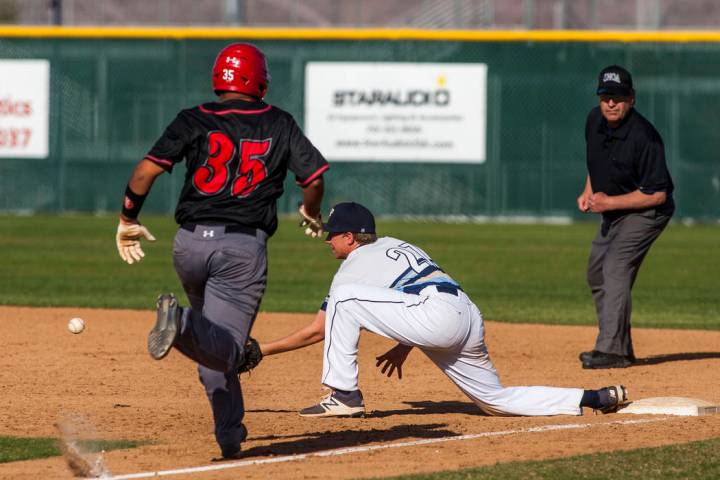 Foothill first baseman Tyler Kara prepares to catch a ball at first base to tag out Las Vega ...