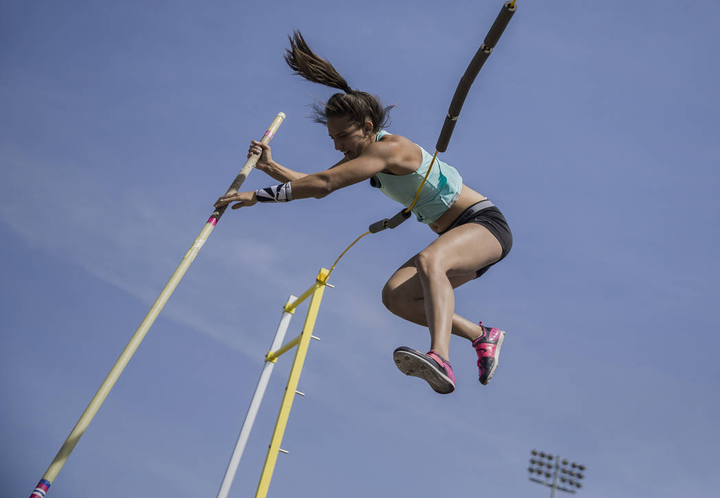 """Gabby Carson, one of Nevada's top prep pole vaulters, works on her """"fly-away&quot ..."""