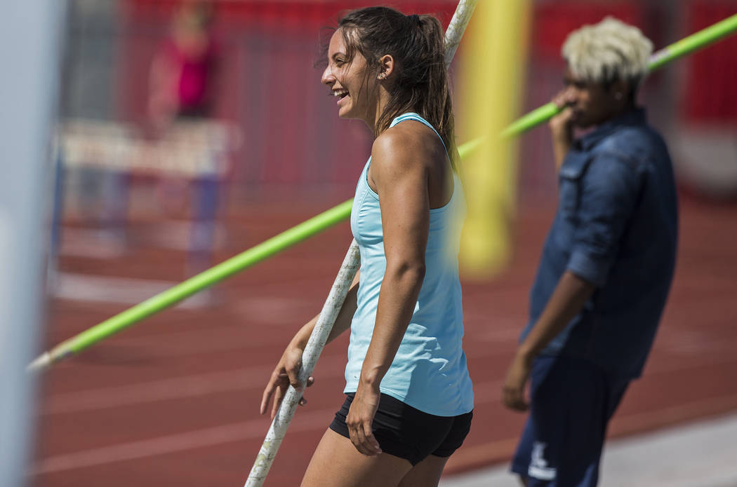 Gabby Carson, left, one of Nevada's top prep pole vaulters, jokes around with teammate ...