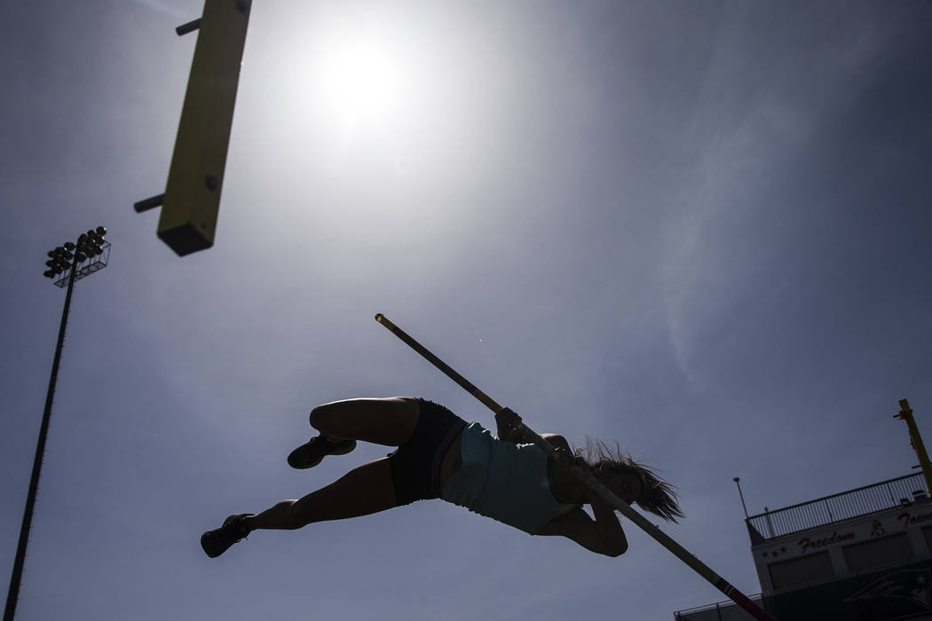Gabby Carson, one of Nevada's top prep pole vaulters, works on her technique during pr ...
