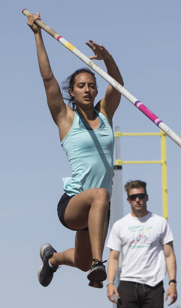 Gabby Carson, left, one of Nevada's top prep pole vaulters, works on her technique dur ...