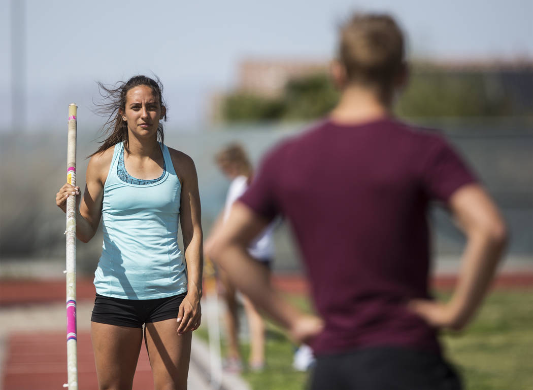 Gabby Carson, left, one of Nevada's top prep pole vaulters, waits to make a jump durin ...